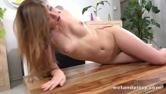 Kinky chick Xiana gets rid of jeans after pissing in the living room