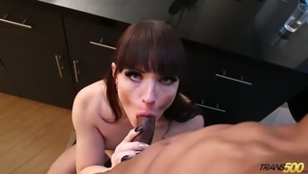 Almost titless ladyboy Natalie Mars sucks delicious black cock properly