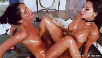 Madison Ivy and August Ames are horny lesbians enjoying a massage