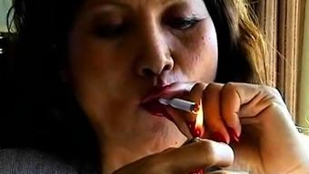 Asian smokes and makes it erotic