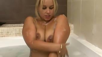 Playful blond head Ashley Rider greedily sucks cock in the foamy bath tub