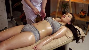 Hot Japanese milf on the massage table for finger fucking