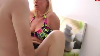 Mature slut gets shagged hard in the kitchen