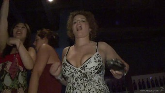 Dynamic party girl flashes her natural tits in public