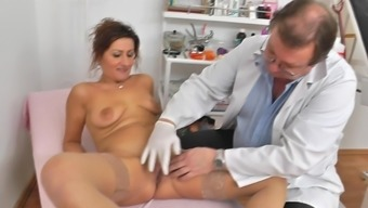 Mature cunt examined by horny gyno