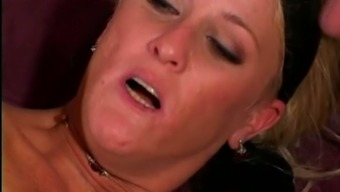 Salacious blonde milf gets double penetrated in group sex scene