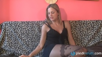 Her sexy nylons cover her hot feet while she kicks back