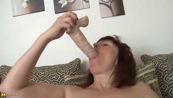 Saucy redhead granny Stephanie strips down and toys her wet snatch