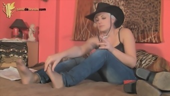 Smoking cowgirl wears a pair of pantyhose under her jeans