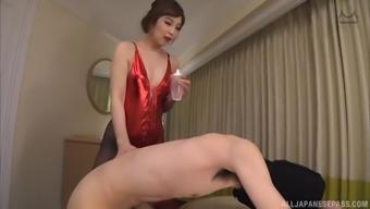 Beautiful Sasaki Aki likes to jerk a dick with her small feet