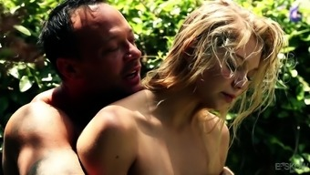 Jessie Andrews giving dick blowjob in the garden