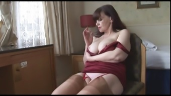 Big tits mature milf shows off sheer panties stockings and