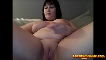Horny bbw shoves a dildo in herself on cam