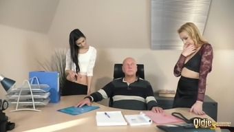 Old manager at the office fucks his two beautiful assistants