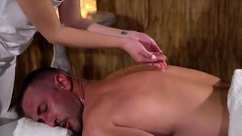 Massage Rooms Petite nymph gives blowjob and handjob