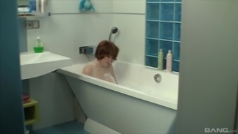 Redhead wife Stella E blows her man in the tub before a fuck