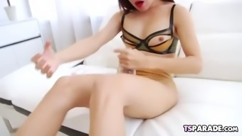 Asian beauty tanny having fun with a toy