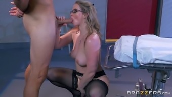 Slutty doctor straps the patient down and sits on his dick