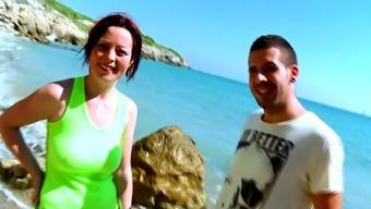 Cute girlfriend takes a pecker at the beach