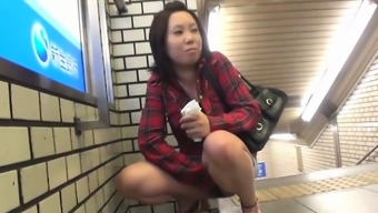 Asian teenager peeing