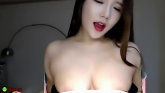 Korean busty camgirl plays with her huge tits