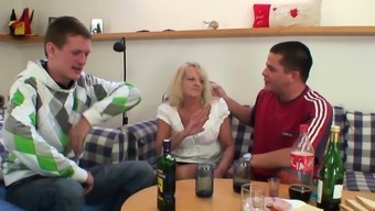 Her old blonde mother enjoys two big cocks