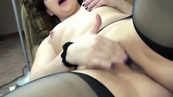 Curvy housewife Naomi St Claire takes off her dress and