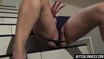 Captivating redhead with impressive curves Alyssa Lynn goes solo on stairs