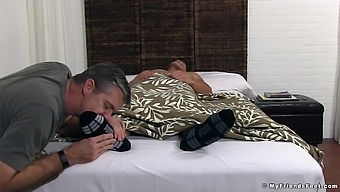 Sleeping guy does not know that his room-mate has a foot fetish