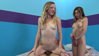 Handsome models Carrie X and Willow Lynn share one stiff dick